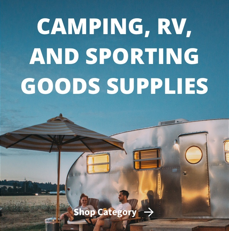 Camping, RV, and Sporting Goods Supplies with camper at evening in background